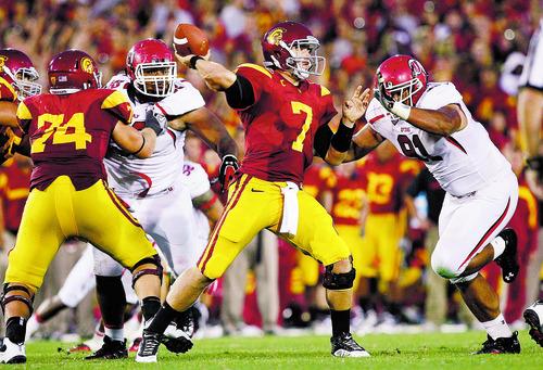 Chris Detrick     The Salt Lake Tribune USC Trojans quarterback Matt Barkley (7) passes the ball during the second half of the game at the Los Angeles Memorial Coliseum on Sept. 10, 2011.  USC won the game 17-14.