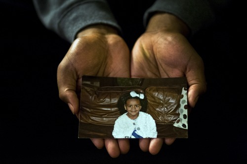 Chris Detrick  |  The Salt Lake Tribune Utah defensive lineman Nate Fakahafua holds a photograph of his daughter Lily when she was 3 years old.