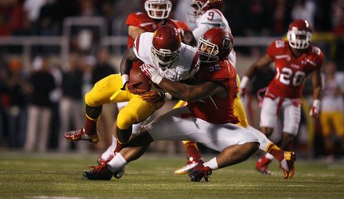 Scott Sommerdorf  |  The Salt Lake Tribune              Utah Utes defensive tackle Star Lotulelei (92) pulls down USC Trojans running back Silas Redd (25) for a loss during during first-half play Oct. 4, 2012, in Salt Lake City.