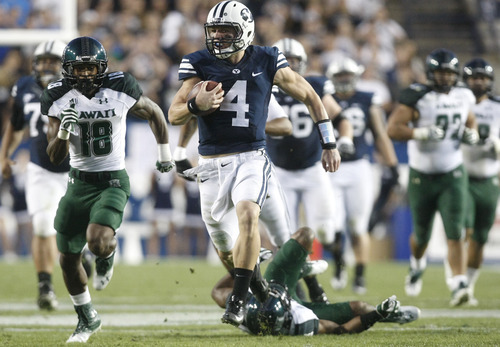 Chris Detrick  |  The Salt Lake Tribune Brigham Young Cougars quarterback Taysom Hill (4), here running for a touchdown against Hawaii, could get the start again Friday against Utah State if senior Riley Nelson can't play.