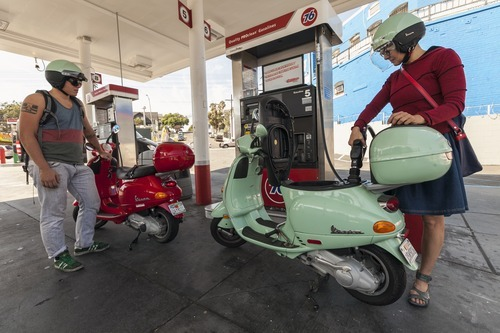 Motorcyclists Hanna Gilan, right, and her son Chaim Gilan fill up their Vespas scooters with less than two gallons at a gas station in the Echo Park district of Los Angeles Thursday, Oct. 4, 2012. Motorists in California paid an average of $4.232 per gallon Wednesday. That's 45 cents higher than the national average and exceeded only by Hawaii among the 50 states. (AP Photo/Damian Dovarganes)