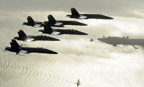 In preparation for Fleet Week performances, the U.S. Navy Blue Angels pass Angel Island in the San Francisco Bay, on Thursday, Oct. 4, 2012. (AP Photo/Noah Berger)