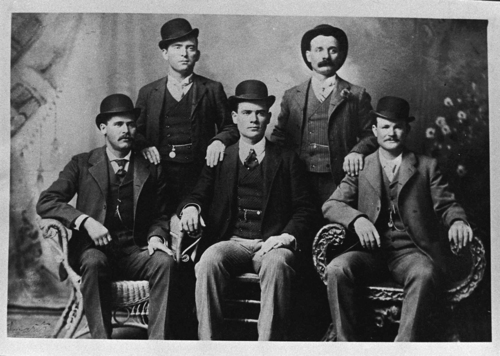 This image provided by the Nevada Historical Society shows the famous group portrait taken in Fort Worth, Texas shortly after Butch Cassidy and his gang robbed the Einnemucca, Nev., bank in 1900. They sent the photo to the bank with a thank you note. Shown are Bill Carver, top left, the Sundance Kid, bottom left, and Butch Cassidy, bottom right. The other two members of the gang are not identified. A collector of rare books and documents has obtained a manuscript with new evidence that Butch Cassidy wasn't killed in a 1908 shootout in Bolivia but returned to the U.S. and lived on in Washington State for almost three decades. (AP Photo/Nevada Historical Society, File)