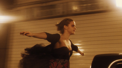 Sam (Emma Watson) stands up in the back of a truck, in a scene from