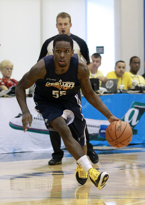 Utah Jazz's Kevin Murphy moves the ball against the Oklahoma City Thunder during an NBA summer league basketball game, Friday, July 13, 2012, in Orlando, Fla. (AP Photo/John Raoux)