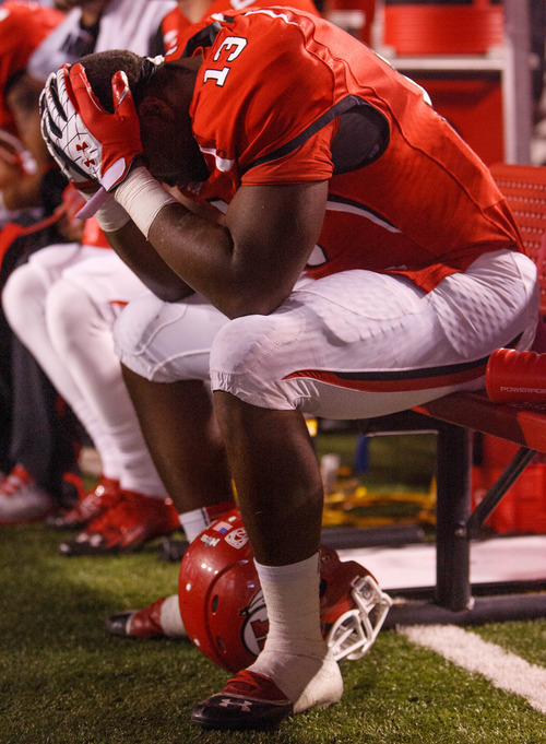 Trent Nelson  |  The Salt Lake Tribune Utah running back Kelvin York (13) holds his head in his hands in the final seconds of the loss to USC on Oct. 4, 2012 at Rice-Eccles Stadium in Salt Lake City.