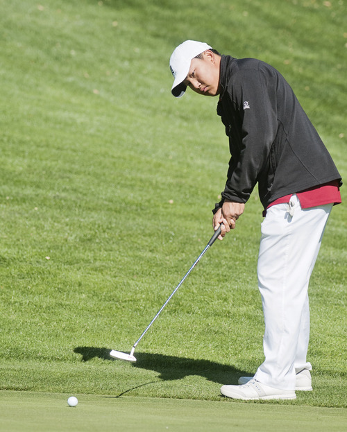 Logan's Justin Kim putts the ball at the 2nd hole while competing in the 4A Boys Golf High School State Championship at Logan Golf and Country Club Thursday. (Jennifer Meyers/Herald Journal)
