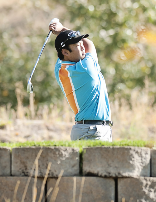 Timpview's C.J. Lee watches his drive at the 2st hole during the 2012 4A Boys Golf Championship at Logan Golf and Country Club Thursday. (Jennifer Meyers/Herald Journal)