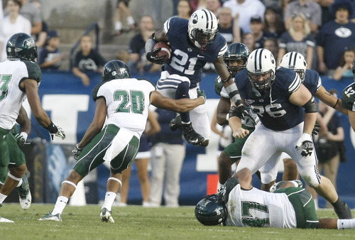 Chris Detrick  |  The Salt Lake Tribune BYU running back Jamaal Williams runs past Hawaii Warriors cornerback Ne'Quan Phillips (20) and linebacker Kamalani Alo (47) on Sept. 28, 2012.