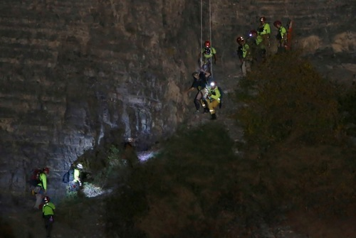 A BASE jumper is rescued after his parachute got caught on a cliff in Provo Canyon late Oct. 1, 2012. Photo by George Frey