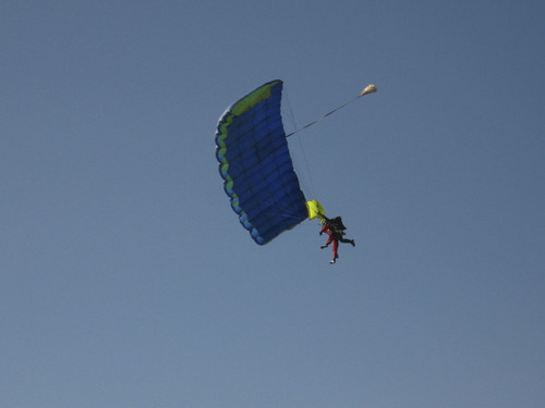 Courtesy of Timothy Micklos Sandy resident Bill Bassett, 85, (in the red) in the midst of his first skydive, floas to the ground in tandem with an instructor from Skydive Ogden.