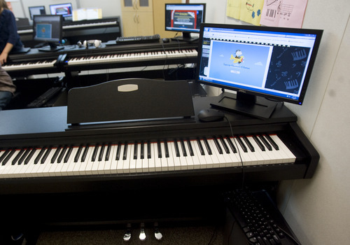 Kim Raff | The Salt Lake Tribune The U Play Piano system, an interactive program featuring stories and games that helps students learn to play the piano at Washington Elementary School in Salt Lake City.