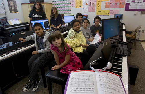 Kim Raff | The Salt Lake Tribune This group of students use UPlay Piano, an interactive program featuring stories and games that helps students learn to play the piano at Washington Elementary School.