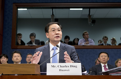FILE - In this Sept. 13, 2012, Charles Ding, Huawei Technologies Ltd's senior vice president for the U.S., testifies on Capitol Hill in Washington, before the House Intelligence Committee as lawmakers probe whether Chinese tech giants' expansion in the U.S. market pose a threat to national security. In a report to be released Monday, Oct. 8, 2012, the House Intelligence Committee is warning that China's two leading technology firms pose a major security threat to the United States. The panel says regulators should block mergers and acquisitions in the U.S. by Huawei Technologies Ltd. and ZTE Corp. It also advises that U.S. government systems not include equipment from the two firms, and that private U.S. companies avoid business with them. (AP Photo/J. Scott Applewhite, File)