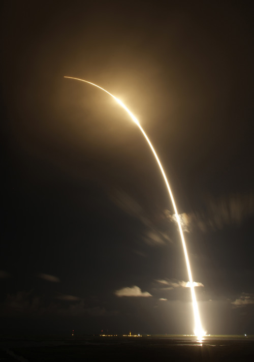 The Falcon 9 SpaceX rocket is shown in a time exposure as it lifts off from space launch complex 40 at the Cape Canaveral Air Force Station in Cape Canaveral, Fla. on Sunday, Oct. 7, 2012. The rocket is carrying supplies to the International Space Station. (AP Photo/Terry Renna)