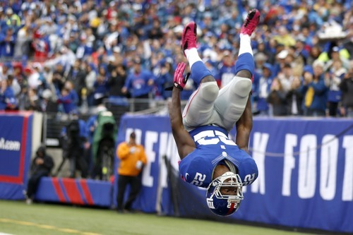 New York Giants running back David Wilson reacts after scoring a touchdown against the Cleveland Browns during the second half of an NFL football game Sunday, Oct. 7, 2012, in East Rutherford, N.J. The Giants won the game 41-27. (AP Photo/Julio Cortez)