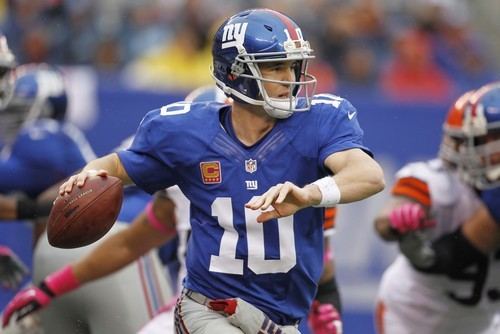 New York Giants quarterback Eli Manning (10) throws a pass during the first half of an NFL football game against the Cleveland Browns Sunday, Oct. 7, 2012, in East Rutherford, N.J. (AP Photo/Julio Cortez)