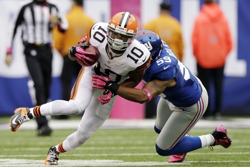New York Giants outside linebacker Michael Boley (59) tackles Cleveland Browns wide receiver Jordan Norwood (10) during the second half of an NFL football game Sunday, Oct. 7, 2012, in East Rutherford, N.J. The Giants won the game 41-27. (AP Photo/Kathy Willens)
