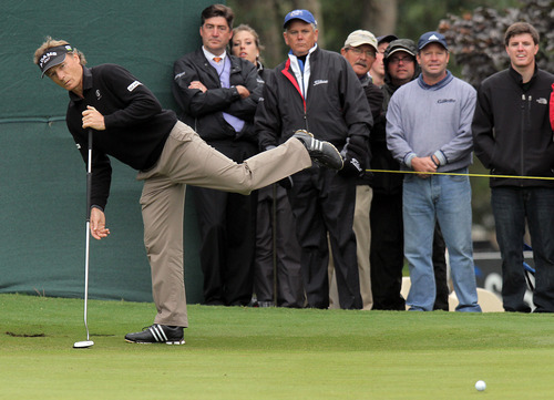 Bernhard Langer reacts to missing a putt and an eagle opportunity on the 17th on his way to winning the SAS PGA Champions Tour golf tournament at Prestonwood Country Club in Cary, N.C., Sunday, Oct. 7, 2012.  (AP Photo/Ted Richardson)