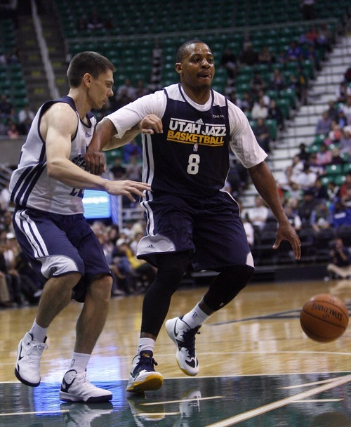 Kim Raff | The Salt Lake Tribune (right) Randy Foye tries to hold off (left) Chris Quinn during the Jazz Scrimmage at EnergySolutions Arena in Salt Lake City, Utah on October 6, 2012.