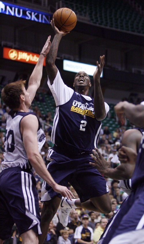 Kim Raff | The Salt Lake Tribune Jazz player (left) Gordon Hayward defends as (right) Jazz player Marvin Williams takes a shot during a Jazz Scrimmage at EnergySolutions Arena in Salt Lake City, Utah on October 6, 2012.