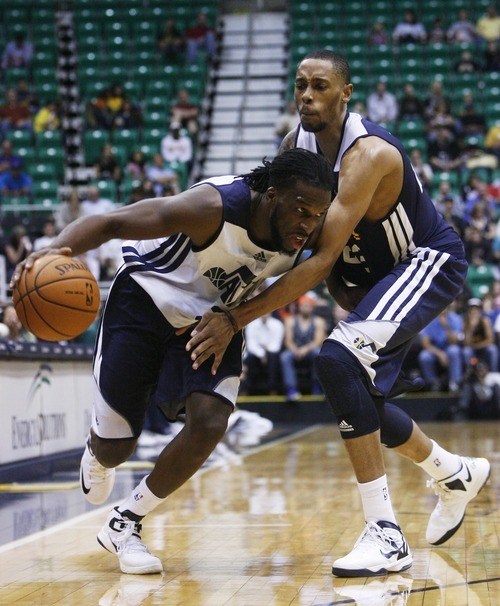 Kim Raff | The Salt Lake Tribune (left) DeMarre Carroll dribbles past Trey Gilder during the Jazz Scrimmage at EnergySolutions Arena in Salt Lake City, Utah on October 6, 2012.