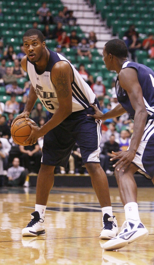 Kim Raff | The Salt Lake Tribune (left) Derrick Favors looks to pass during a Jazz Scrimmage at EnergySolutions Arena in Salt Lake City, Utah on October 6, 2012.