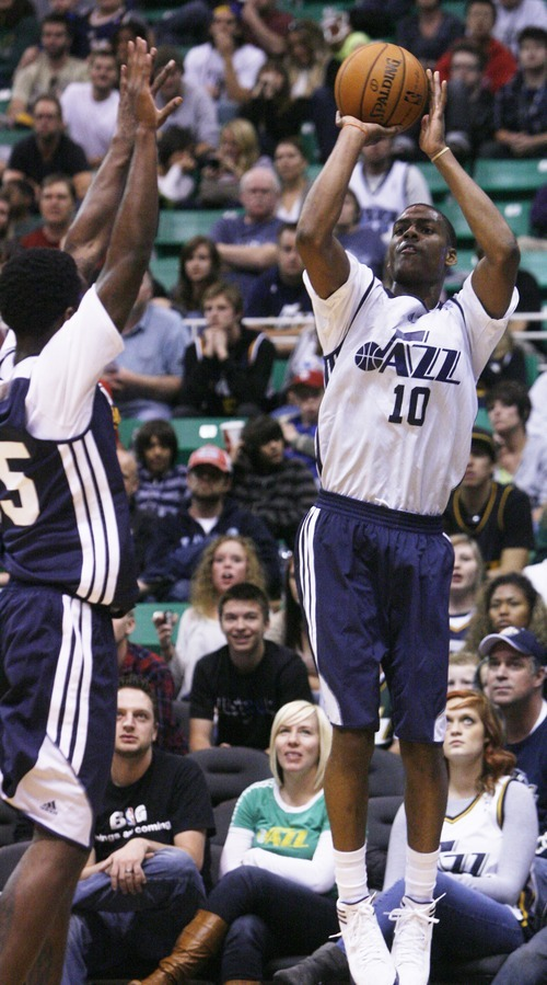 Kim Raff | The Salt Lake Tribune (right) Aleck Burks takes a jump shot during the Jazz Scrimmage at EnergySolutions Arena in Salt Lake City, Utah on October 6, 2012.