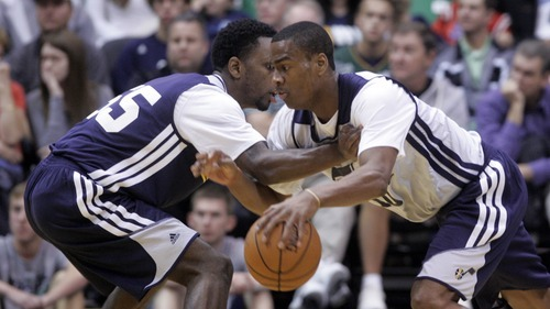 Kim Raff | The Salt Lake Tribune (right) Alec Burks dribbles past Kevin Murphy during the Jazz Scrimmage at EnergySolutions Arena in Salt Lake City, Utah on October 6, 2012.