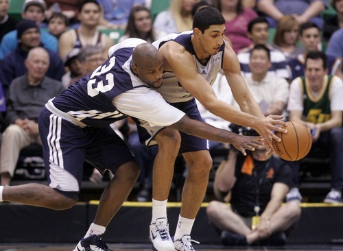 Kim Raff | The Salt Lake Tribune Jazz players (left) Darnell Jackson and (right) Enes Kanter fight for a loose ball during the Jazz Scrimmage at EnergySolutions Arena in Salt Lake City, Utah on October 6, 2012.