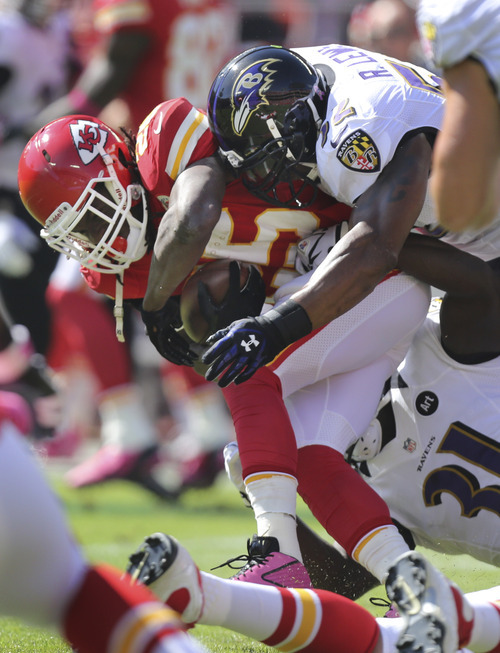 Kansas City Chiefs running back Jamaal Charles (25) is tackled by Baltimore Ravens inside linebacker Ray Lewis (52) and strong safety Bernard Pollard (31) during the first half of an NFL football game at Arrowhead Stadium in Kansas City, Mo., Sunday, Oct. 7, 2012. (AP Photo/Ed Zurga)