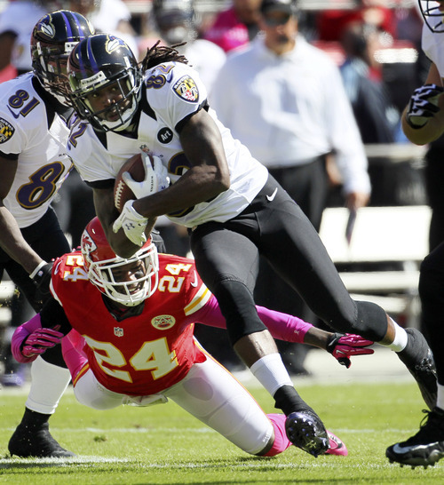 Baltimore Ravens wide receiver Torrey Smith (82) gets past Kansas City Chiefs cornerback Brandon Flowers (24) during the first half of an NFL football game at Arrowhead Stadium in Kansas City, Mo., Sunday, Oct. 7, 2012. (AP Photo/Colin E. Braley)