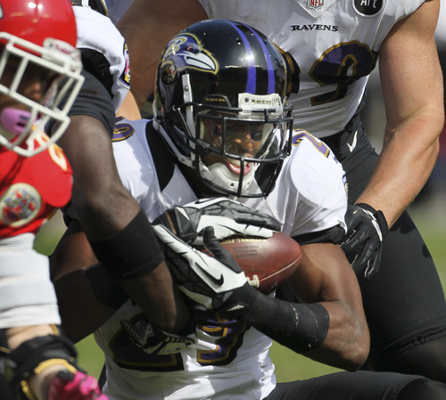 Baltimore Ravens cornerback Cary Williams (29) intercepts a pass during the second half of an NFL football game against the Kansas City Chiefs at Arrowhead Stadium in Kansas City, Mo., Sunday, Oct. 7, 2012. (AP Photo/Colin E. Braley)