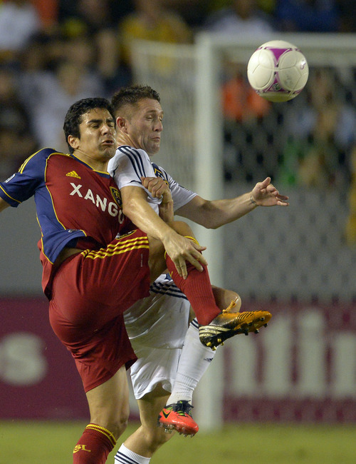 Real Salt Lake's Tony Rimando, left, and Los Angeles Galaxy's Robbie Keane battle for the ball during the second half of their MLS soccer match on Saturday, Oct. 6, 2012, in Carson, Calif. Real Salt Lake won 2-1. (AP Photo/Mark J. Terrill)