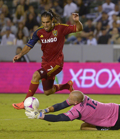 Mark J. Terrill | The Associated Press Los Angeles Galaxy goalkeeper Josh Saunders, right, makes a save on a shot by Real Salt Lake's Fabian Espindola during the second half of an MLS soccer match, Saturday, Oct. 6, 2012, in Carson, Calif. Real Salt Lake won 2-1. (AP Photo/Mark J. Terrill)