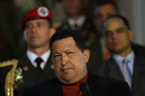 Venezuela's President Hugo Chavez listens to a question during an impromptu news conference with the foreign press at Miraflores palace in Caracas, Venezuela, Saturday, Oct. 6, 2012. Chavez is running for re-election against opposition candidate Henrique Capriles in Sunday's presidential election. (AP Photo/Ramon Espinosa)