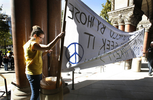 Scott Sommerdorf  |  The Salt Lake Tribune              Organizers of The October 7th Committee set up a banner at the start of their rally supported by several anti-war and veterans' groups. They held a rally at the City and County Building on the 11th anniversary of the invasion of Afghanistan for Utahns to come together and voice their opposition to U.S. wars throughout the world, Sunday, October 7, 2012.