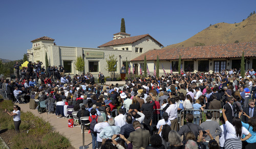 President Barack Obama announces the establishment of the Cesar E. Chavez National Monument, Monday, Oct. 8, 2012, in Keene, Calif. The property is recognized worldwide for its historic link to civil rights icon Cesar  Chavez and the farm worker movement. (AP Photo/Mark J. Terrill)