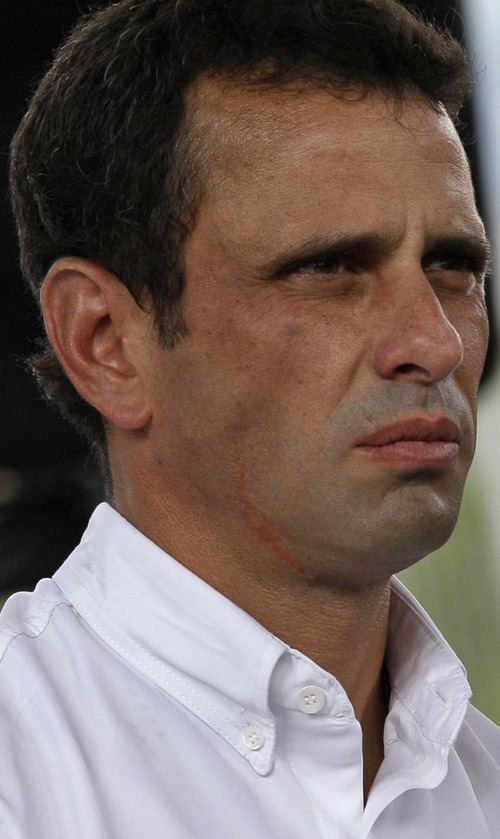 Opposition presidential candidate Henrique Capriles talks to journalists after voting  at a polling station in Caracas, Venezuela, Sunday, Oct. 7, 2012. Venezuela's electoral council says President Hugo Chavez has won re-election, defeating challenger  Capriles.(AP Photo/Ariana Cubillos)