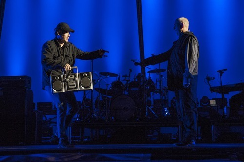 Actor John Cusack passes the boom box to Peter Gabriel during his perfomance of the album So at Hollywood Bowl on October 6, 2012 in Los Angeles, California.