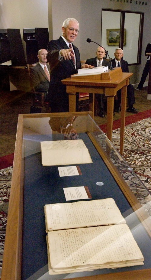 Tribune file photo In this 2009 photo, LDS Church Historian and Recorder Marlin K. Jensen points out original handwritten  documents in a glass case from manuscripts that were collected and published in a full-color volume of 800 pages as The Joseph Smith Papers, second edition.