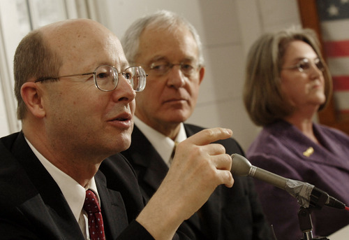 Richard E. Turley Jr., left, assistant church historian for The Church of Jesus Christ of Latter-day Saints, answers a question as Marlin Jensen, center, historian for the faith, and Patty Norris, president of the Mountain Meadows Massacre Descendants, listen during a press conference on Friday, March 28, 2008, in Carrollton, Ark. (AP Photo/Beth Hall)