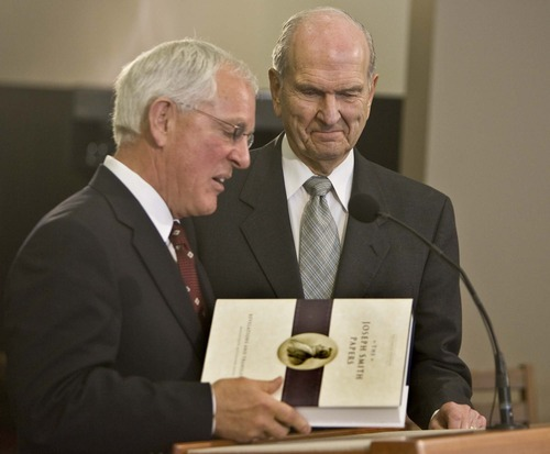 Tribune file photo In this 2009 photo,  LDS Church Historian and Recorder Marlin Jensen presents Elder Russell M. Nelson of the Quorum of the Twelve Apostles with a copy of The Joseph Smith Papers, volume two.