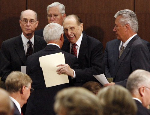 Tribune file photo LDS Church President Thomas S. Monson laughs while hugging Church Historian Marlin K. Jensen before dedication of the Church History Library.