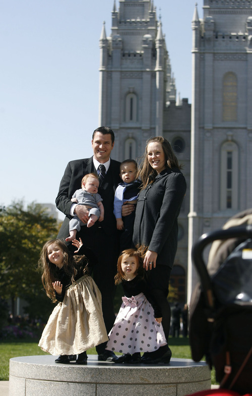Scott Sommerdorf     The Salt Lake Tribune              The Miler family from South Jordan has their photo taken in Temple Square before the start of the afternoon session of the 182nd Semiannual General Conference, Saturday, October 6, 2012.