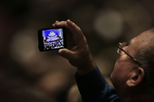 Scott Sommerdorf     The Salt Lake Tribune              A man makes a photo inside the Conference Center prior to the start of the afternoon session of the 182nd Semiannual General Conference, Saturday, October 6, 2012.