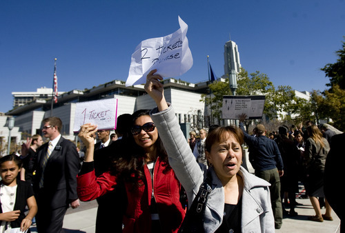 Kim Raff  |  The Salt Lake Tribune Glaucia De Oliveira, left, and Elke Barros, both from Brazil, hold up a sign hoping to get tickets to the afternoon session of the 182nd Semiannual General Conference of the LDS Church in Salt Lake City on Sunday, October 7, 2012.