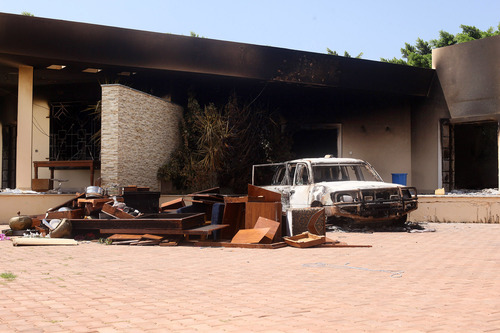 A burnt car is seen after an attack on the U.S. Consulate by protesters angry over a film that ridiculed Islam's Prophet Muhammad in Benghazi, Libya, Wednesday, Sept. 12, 2012. The U.S. ambassador to Libya and three other Americans were killed. (AP Photo/Ibrahim Alaguri)