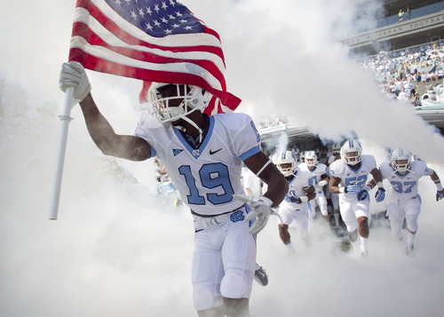 North Caroliona's Quinshad Davis (14) leads the Tar Heels into Kenan Stadium for their NCAA college football game against Virginia Tech, Saturday, Oct. 6, 2012, in Chapel Hill, N.C. (AP Photo/The News & Observer, Robert Willett)  MANDATORY CREDIT