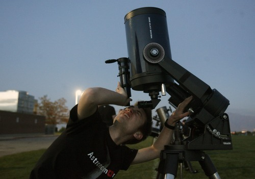 Kim Raff | The Salt Lake Tribune Zack Carson of the University of Utah Astronomy program sets up a telescope during the Copper Hills High Math, Engineering and Science Association's annual
